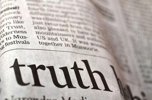 Newspaper with the word Truth in bold